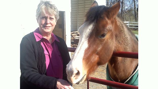 Karen Washburn spends time with her horse, Toby, at their home in Great Falls, Va. Washburn says that one of the best parts about life in Great Falls is the abundant wildlife and open spaces.