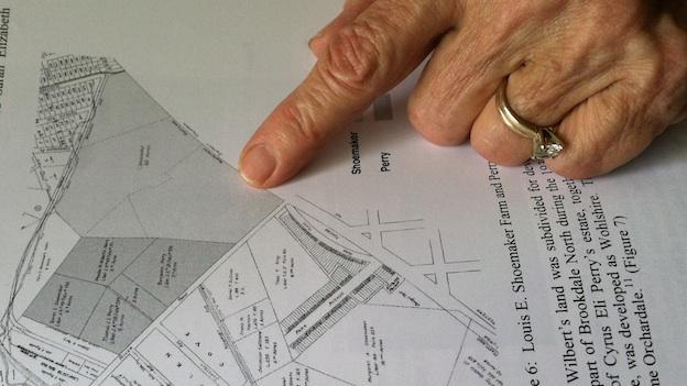 Brookdale, Md. resident Amy Rispin points to her neighborhood on a map.