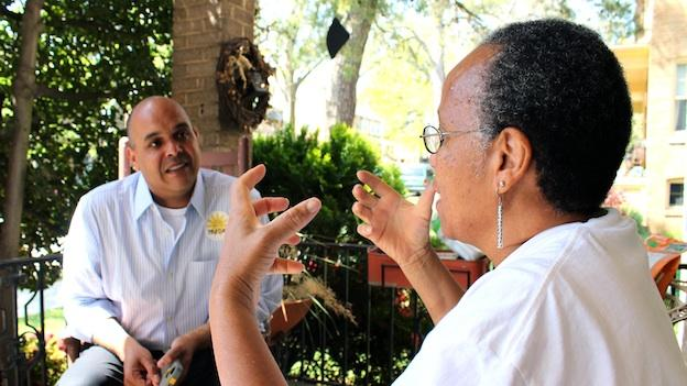Ward 5 candidate Tim Day talks with voter Clarencetta Jelks while campaigning.