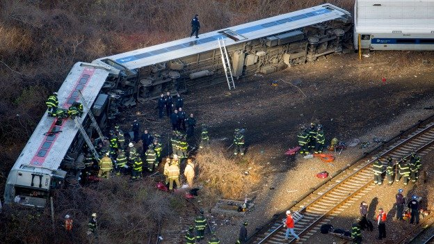 First responders work the scene of a derailment of a Metro-North passenger train in the Bronx borough of New York Sunday, Dec. 1, 2013. The train derailed on a curved section of track in the Bronx, coming to rest just inches from the water and causing multiple fatalities and dozens of injuries, authorities said. Metropolitan Transportation Authority police say the train derailed near the Spuyten Duyvil station.