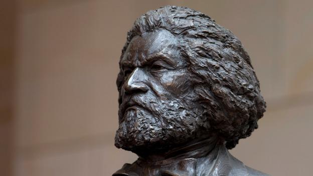 A bronze statue of 19th-century orator and writer Frederick Douglass is seen in the Emancipation Hall of the United States Visitor Center on Capitol Hill.