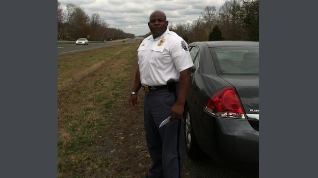 Prince George's County Police District Commander Major James Harper on the scene of a 2008 drag racing incident that killed 8 people on Route 210.