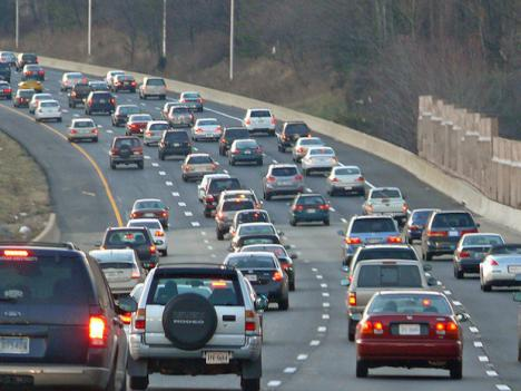 Cars drive along the Dulles Toll Road