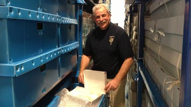 Bob Sonderman is director of the National Park Service's Museum Resource Center in Landover, Md. He unpacks one of the objects from Ellis Island, currently being stored at the Landover facility.