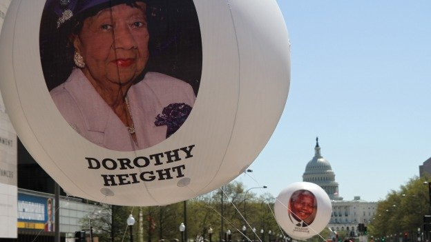 The Emancipation Day parade included balloons bearing images of famous civil rights fighters.