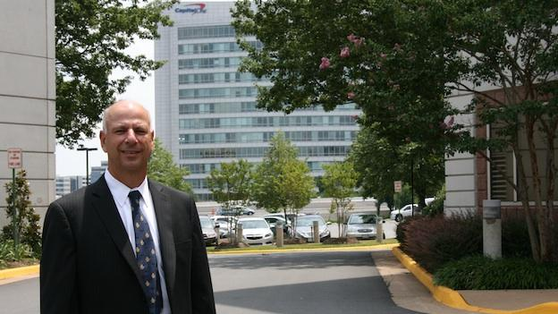 Fairfax County Economic Development Authority President and CEO Jerry Gordon stands in front of Capital One headquarters in Fairfax County, Va.