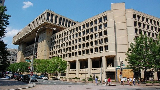 The FBI is slated to move from Pennsylvania Avenue to a suburban site in Maryland or Virginia, but one D.C. statehood advocate says he'll sue to stop it.