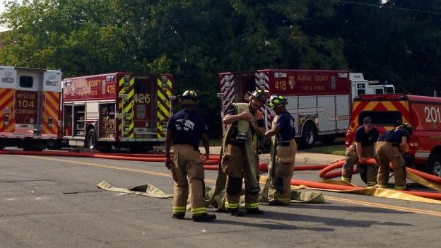 Crews started packing up hoses on Monday afternoon after a six-alarm warehouse fire in Alexandria was contained.