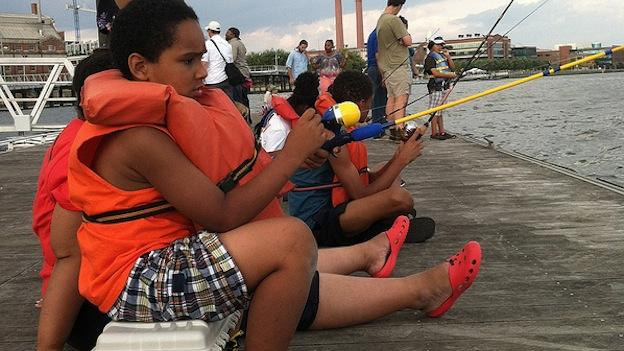 This summer, kids from the D.C. region have gathered along the Anacostia River at Diamond Teague Park to learn how to fish.