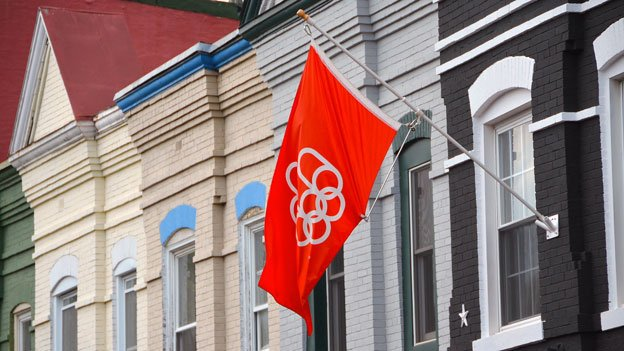 A flag from the 1976 Olympics in Montreal flies outside a house in Adams Morgan.