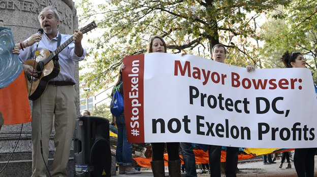 Environmentalists protest the Pepco-Exelon merger during a march in Franklin Square late last year.