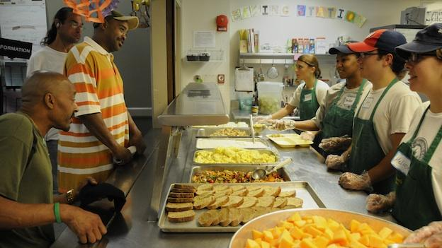 Miriam's Kitchen volunteers serve daily meals to people experiencing homelessness in Washington.