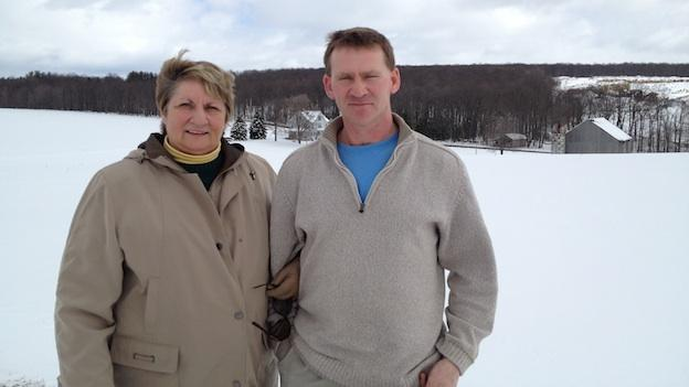 Joyce and Billy Bishoff standing near their 300-acre dairy farm in Garrett County, Md.