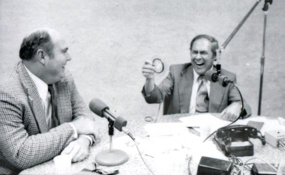Fred Fiske has a laugh in the studio with Willard Scott.