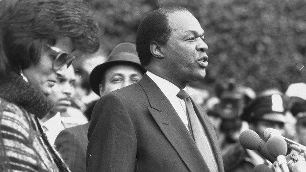 Mayor Marion Barry, with his wife Effi Barry, speaking at press conference outside the U.S. District courthouse after facing drug charges.