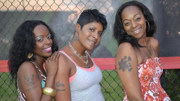 "The ""First Ladies"" of the Goodman League strike a pose at the basketball court in Barry Farms, in Southeast Washington D.C. Pictured from left is Tangie Travers, DNice Reeves, and Tya Travers."