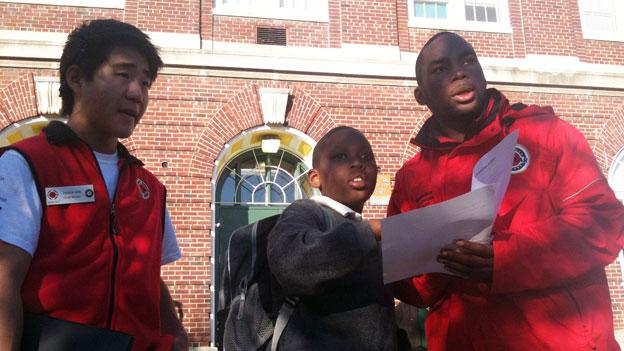 City Year volunteers at Browne Education Campus check a students' homework before class.