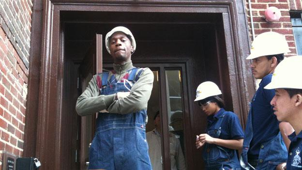Students at YouthBuild Public Charter School take a much-needed break from their work rehabilitating low-income housing. They spend half their time learning the construction trade, and the other half working on their G.E.D. certificates.