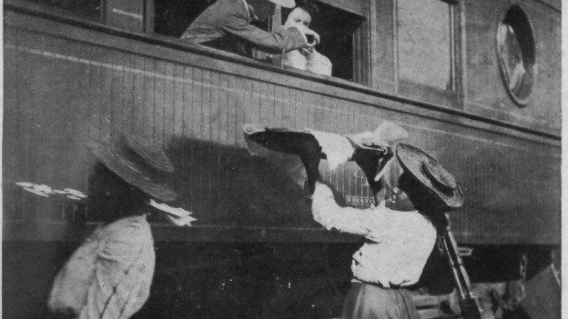 Waiter carriers serving food to passengers on a train passing through Gordonsville.