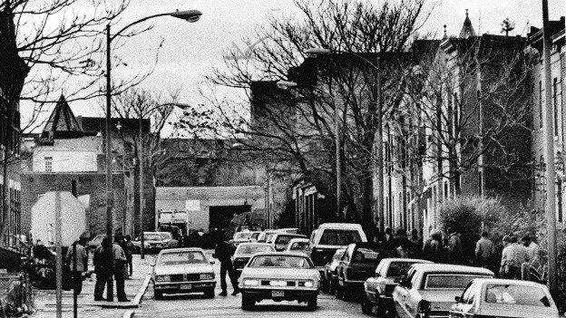 Early evening on Hanover Place NW, just off of North Capitol Street, on December 6, 1984. Hanover Place was a notorious open-air drug market.