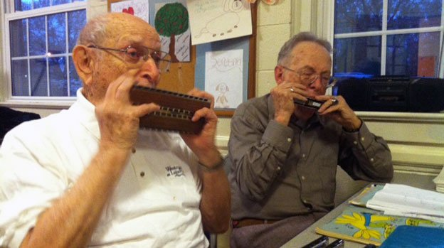Jack Hopkins, left, and Frank Jamison, right, jam together at weekly meetings of the Capital Harmonica Club, which Jack founded in 1991.