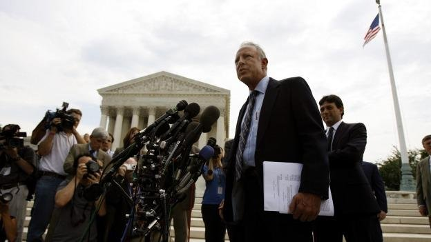Dick Anthony Heller, an armed security guard who sued the District of Columbia after it rejected his application to keep a handgun at his Capitol Hill home, spoke outside the Supreme Court on June 26, 2008 after it struck down the city's handgun ban.