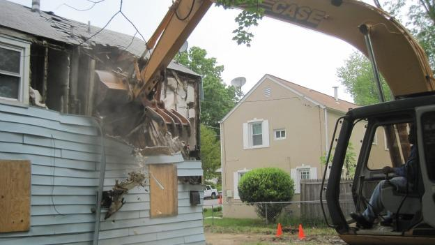 An abandoned home was razed yesterday in Prince George's County, and at least 40 more are to follow.
