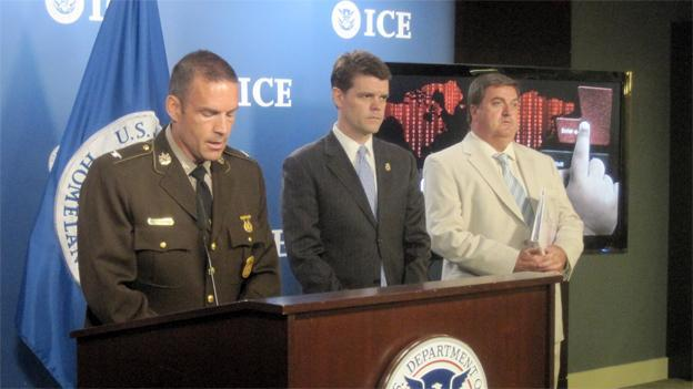 Maryland State Police Superintendent Colonel Marcus Brown speaks at ICE headquarters in DC. Next to him on the right is ICE Director John Morton.