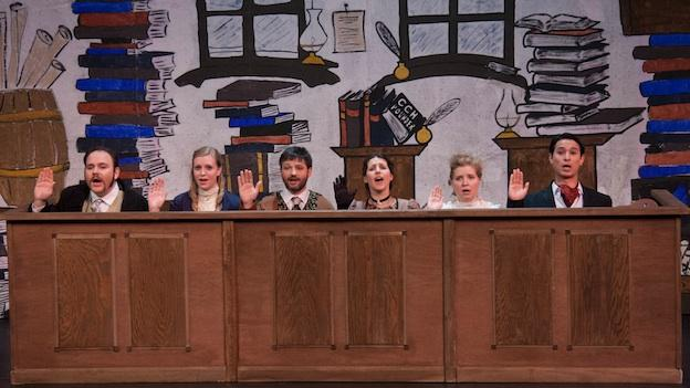 "Members of the ""jury"" sing out in the Georgetown Gilbert & Sullivan Society's 40th anniversary production of Trial By Jury."