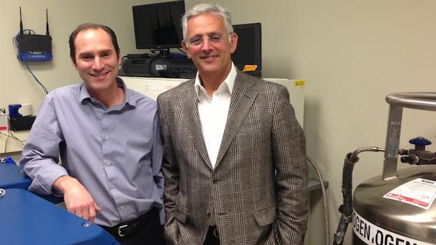 Thomas Hazel, Ph.D, and Richard Garr pose in their neural stem cell laboratory, in Rockville, Md.