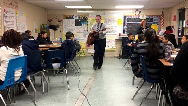 Rogers Heights Elementary School teacher Ari Stern sings songs in math class.