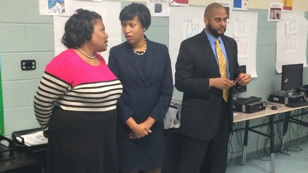 D.C. Schools Chancellor Kaya Henderson spoke to Mayor-elect Muriel Bowser during a tour of Kelly Miller Middle School on Thursday. They were joined by Principal Abdullah Zaki, at right.