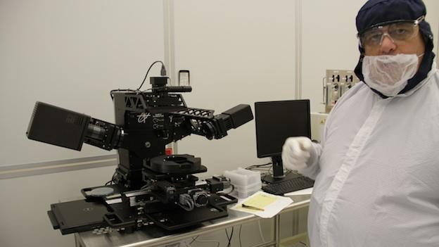 "Vincent Luciani, NanoFab manager, models the ""Bunny Suit"" as he shows off some of the center's nanoscience equipment."