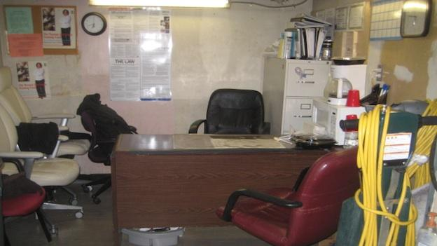 Office where cleaning equipment is stored and where Roberto meets with his employees.