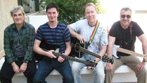 "The Diplomats' original members were all employees at the Embassy of Hungary. Today, the rock'n'roll and blues band's members don't all work at the Hungariuan Embassy, but they do have diplomatic and/or Hungarian ties. (From left to right: drummer ""Rigo Janty,"" bassist Akos Veisz, singer Bryan Dawson, and guitarist David Rakviashvili)"