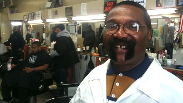 "John Campbell at ""Campbell's Barbershop"" in Ward 7. Campbell's been cutting hair for over 40 years."