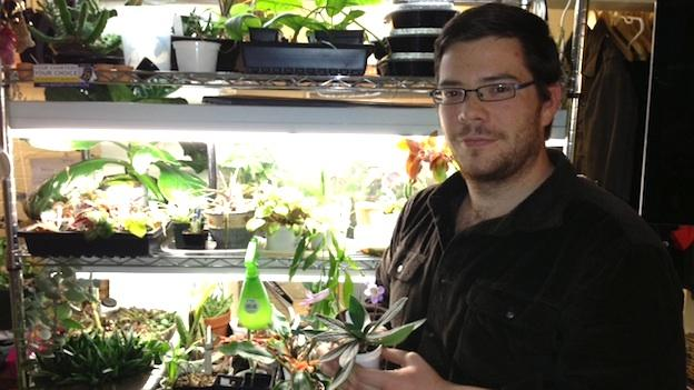 Kenneth Moore, 27, shows off his indoor garden at his apartment in Columbia Heights.