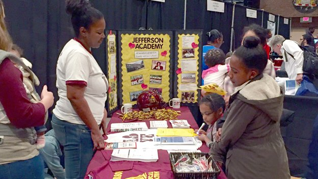 The Jefferson Academy booth at EdFEST, D.C.'s public school fair in December, tries to  attract students to the middle school. Jefferson is eschewed  by many parents of students from Capitol Hill feeder school Brent  Elementary.
