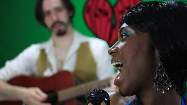 Mary (Felicia Curry) serenades Chris, also known as Jesus (Vaughn Irving) in Disco Jesus and the Apostles of Funk.