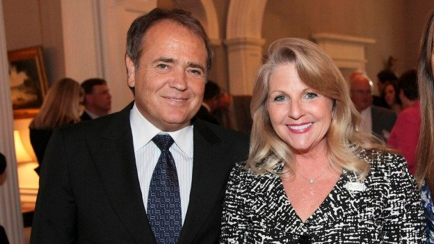 In this May 5, 2011 file photo provided by the office of the Governor of Virginia, Jonnie Williams left, and Maureen McDonnell, wife of then Gov. Bob McDonnell, pose for a photo during a reception for a NASCAR race at the Executive Mansion in Richmond, Va.