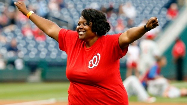 Kaya Henderson, chancellor of Washington public schools, reacts after throwing out a ceremonial first pitch, before a baseball game between the Washington Nationals and the Philadelphia Phillies at Nationals Park Wednesday, June 4, 2014, in Washington.