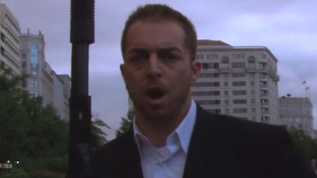 Kokesh is seen hearing loading a shotgun in D.C.'s Freedom Plaza.