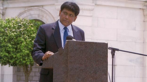 T. Kumar speaks in front of the U.S. Capitol.