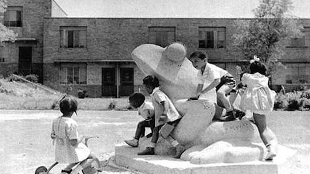 Children play on the Frog, sculpted by Lenore Thomas Strauss, in the courtyard of Langston Terrace.