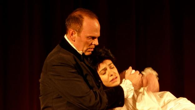 Jean Valjean comforts the prostitute Fantine, who has sold her hair and her body out of desperation.
