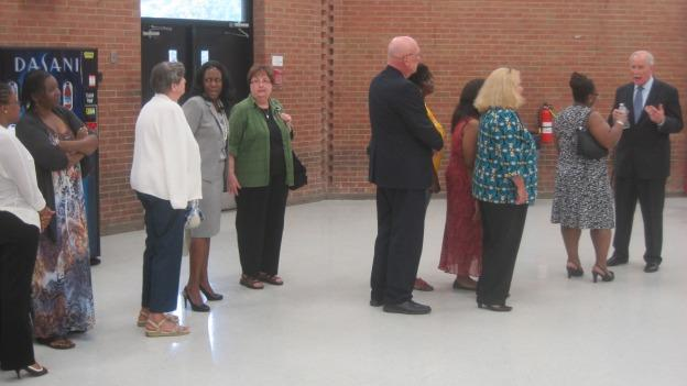 Parents line up to meet Dr. Kevin Maxwell, at right, the new superintendent of the Prince George's County Schools.