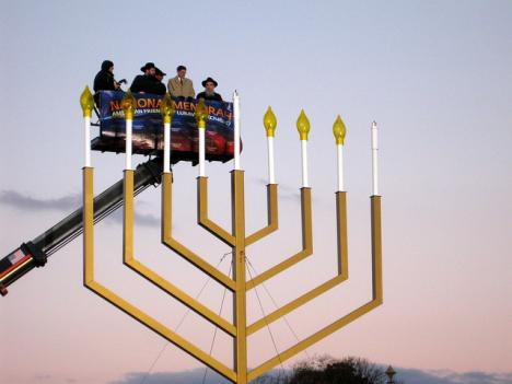 A group lights the national menorah in 2010.