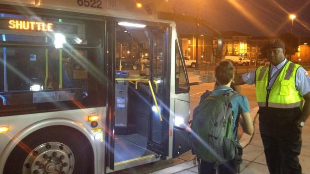 A Metrobus driver directing a passenger to a shuttle at the Ft. Totten station this morning.