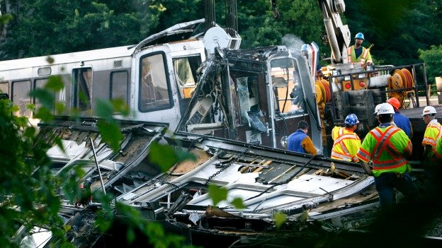 In this file photo from June 23, 2009 officials continue to work around the scene of a rush-hour collision between two Metro transit trains in Northeast Washington, D.C.