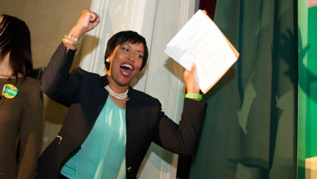D.C. Mayoral candidate, and Council Member Muriel Bowser celebrates as she walks onstage to address supporters at her election night watch party to await the Democrate Primary results.